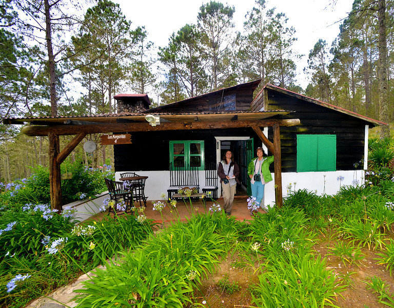 Holly and Lisa in front of our cabin at Villa Pajon
