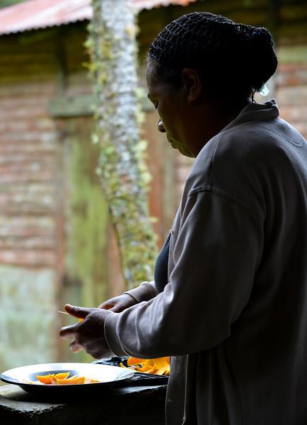 Nat's aunt preparing mangoes for breakfast at Canto del Jilguero, Cachote, Sierra de Bahoruco Oriental