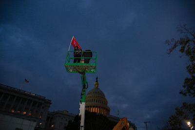 Demonstrators occupy construction equipment outside the U.S. Capitol