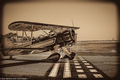 Airplanes Vintage Bi-Plane on Runway -sepia