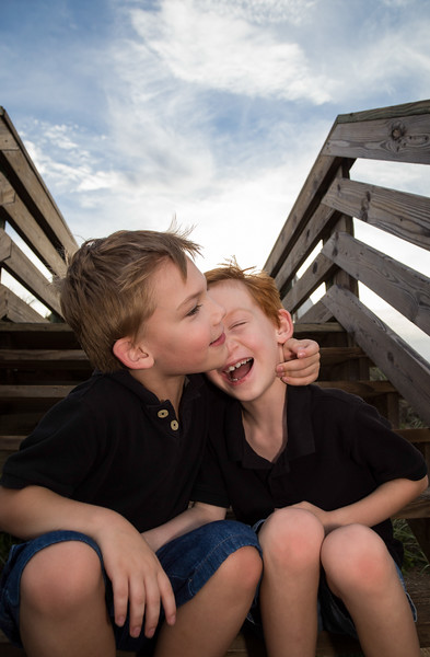 Brothers laughing on steps