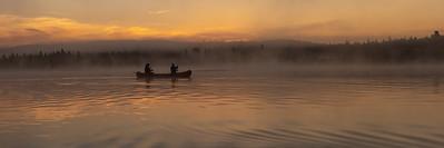 Paddling By at Sunrise