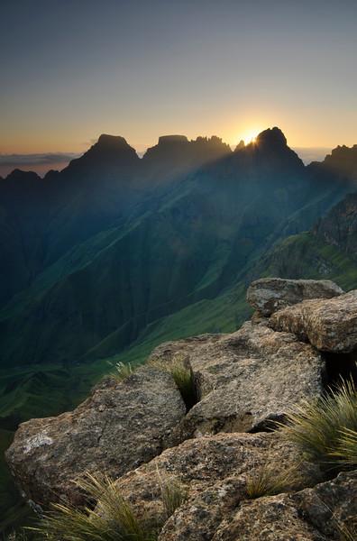 Sun rising through PEaks, Drakensberg, South Africa