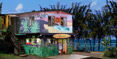 Planet Surf Artography  DrewToonz painted the entire building in wonderful murals.  Photographed in 2003. The surf shop moved into Hale'iwa Town, the building has been repainted grey and is empty as of late 2008. 2013 and still sitting vacant and sad.  Corner of Pupukea and Kamehameha Hwy, across from Foodland, and Shark's Cove  North Shore of O'ahu Andrew Miller, artist