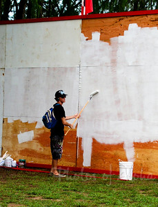Drew priming the backdrop at Ehukai Beach Park, so he can paint another of his fabulous surf murals on it.  Xbox Gerry Lopez Pipeline Masters Banzai Pipeline, North Shore, Oahu 2003  Unfortunately I left town, and didn't get to see the finished art. Andrew Miller, artist