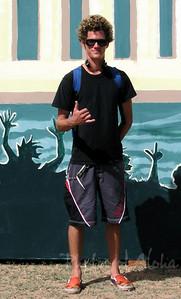 Drew gives the shaka in front of his mural.  Ali'i Beach Park 2003 Andrew Miller, artist