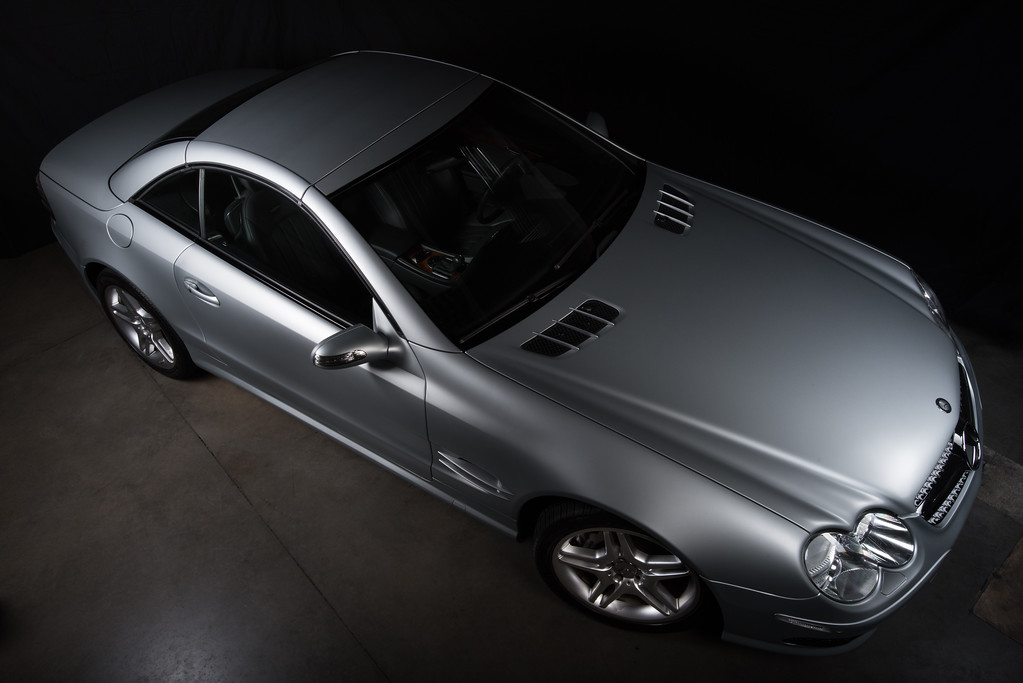 8637 – Entire car at high angle with three flash units and black background