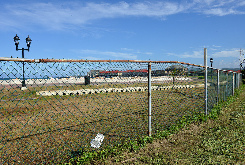 The Falmouth cruise port is completely fenced off from the community. Street lights and paved walking paths are on the tourist (terminal) side of the fence.