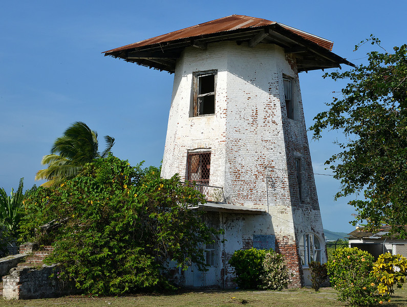 Brick windmill, Alley, Jamaica. This is the only brick windmill in the country, and it once powered the crushers that served the Moneymusk sugar cane plantation. Alley, Jamaica, by Ted Lee Eubanks.