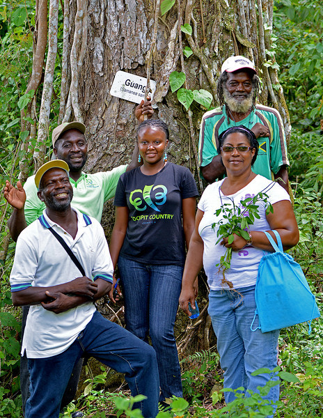 Local officials giving a tour of the Flagstaff area, Jamaica, by Ted Lee Eubanks. The photograph is taken along one of the trails they have developed in the area.