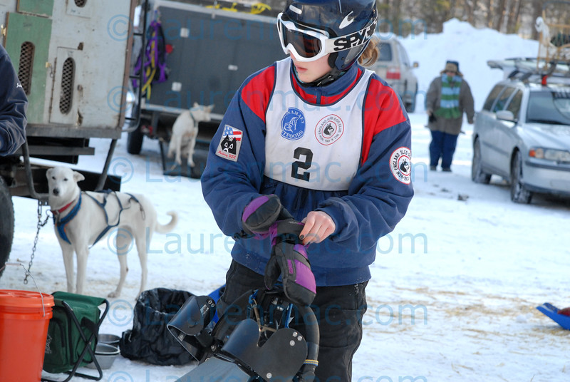 Rachel Colbath prepares for the six mile, Six Dog Pro race on Sunday. The 2011 Myopia Dog Sled Races were held at Appleton Farms in Ipswich, MA.