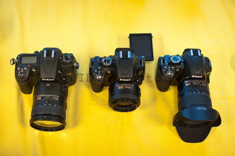 Nikon D5100 with 35mm f/1.8  next to D7000 with 18-200mm VRII and D3100 with 10-24mm