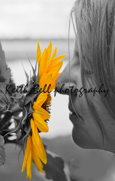 Jenny smelling a sunflower.  Converted to BW with yellow isolation.
