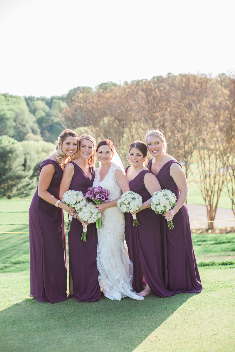 Samantha and her bridesmaids at Hunt Valley Golf Club just outside of Washington, DC. The bridesmaid dresses were purple. The DC wedding photographer was Jalapeno Photography.