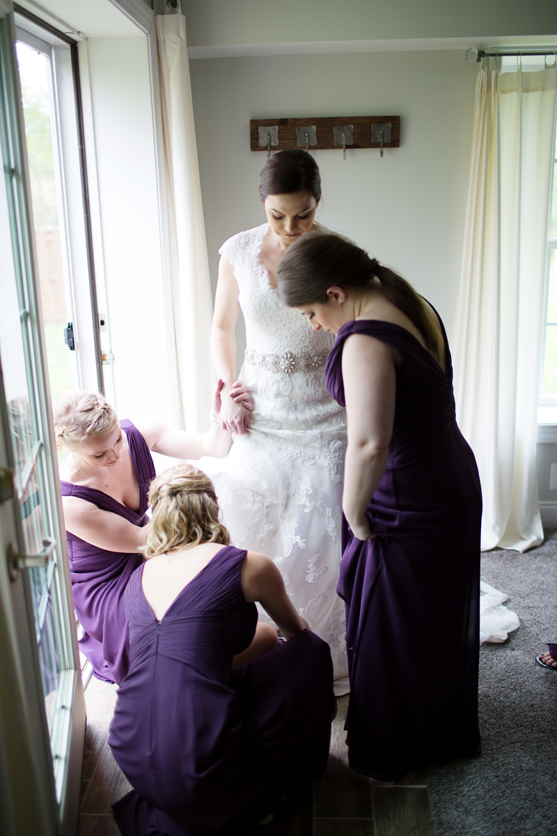Samantha got ready with her bridesmaids who wore deep purple/ eggplant bridesmaid dresses. Wedding photos by Jalapeno Photography.