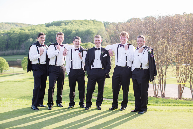 The groom and groomsmen at their Hunt Valley Golf Club. The groomsmen are in tuxes with purple ties. The DC area photographer was Jalapeno Photography.