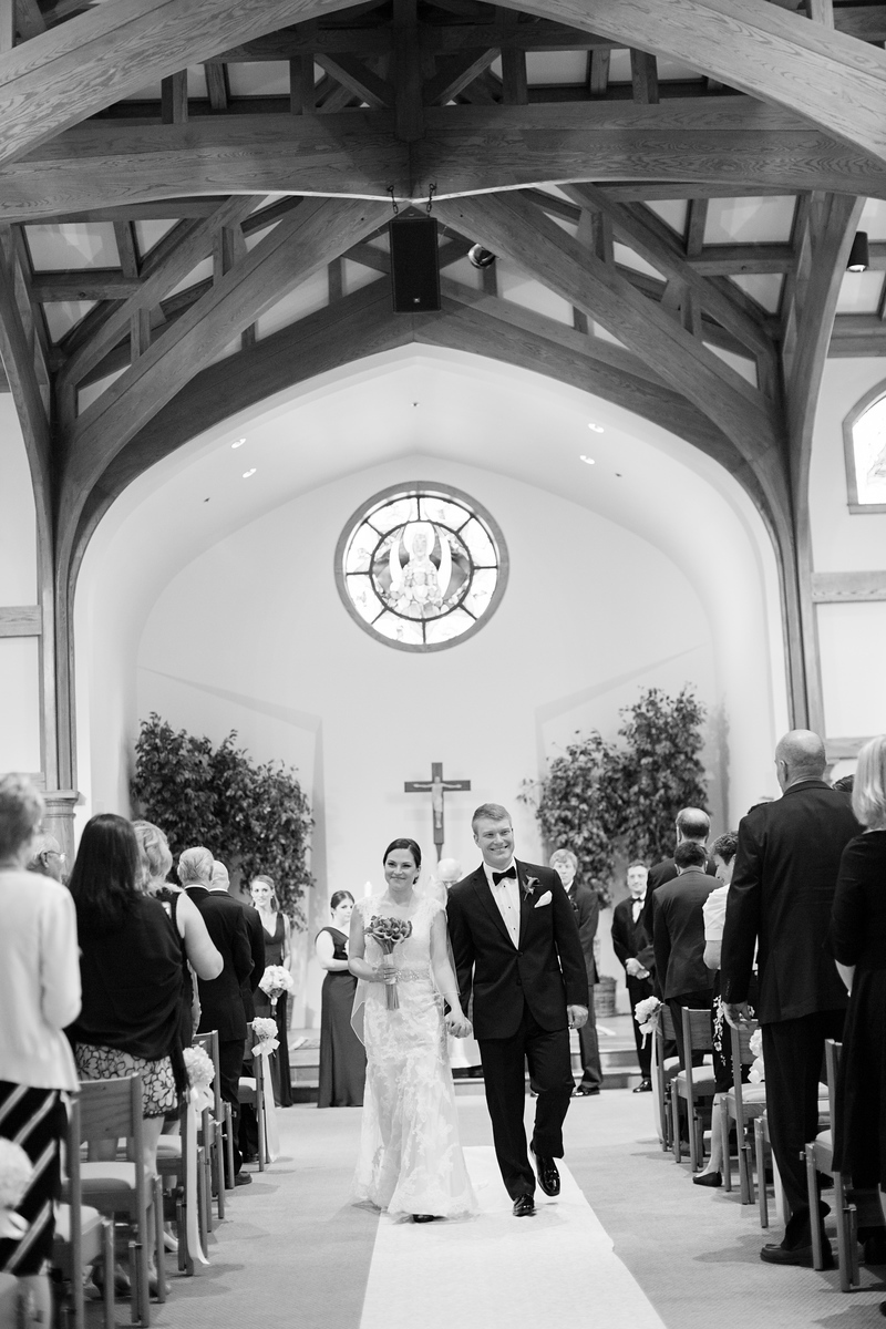 Bride and groom during the recession at their Loyola Blakefield High School Chapel wedding just outside of Baltimore. Photos by Jalapeno Photography.