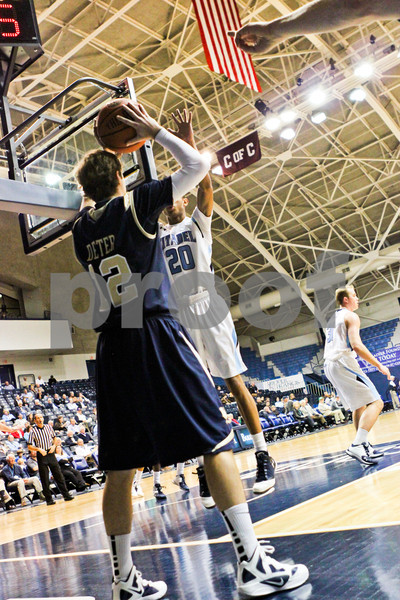 Mitchell Deter (12, CSU) looks for a lane around Barry Smith (20, Citadel) to inbound the ball. The Buccaneers beat the Bulldogs, 88-69.