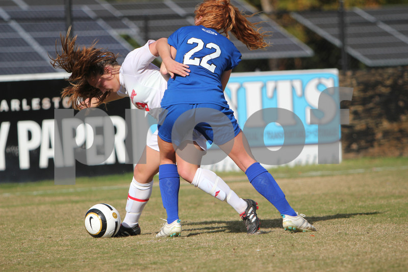 Radford's Stephanie Herb (13) and UNC-Asheville's Ferris Robert's (22) fight for control of the ball. Radford defeated UNC-Asheville in a Penalty Kick Shootout in the Quarter Finals of the Big South Conference Championship tournament,
