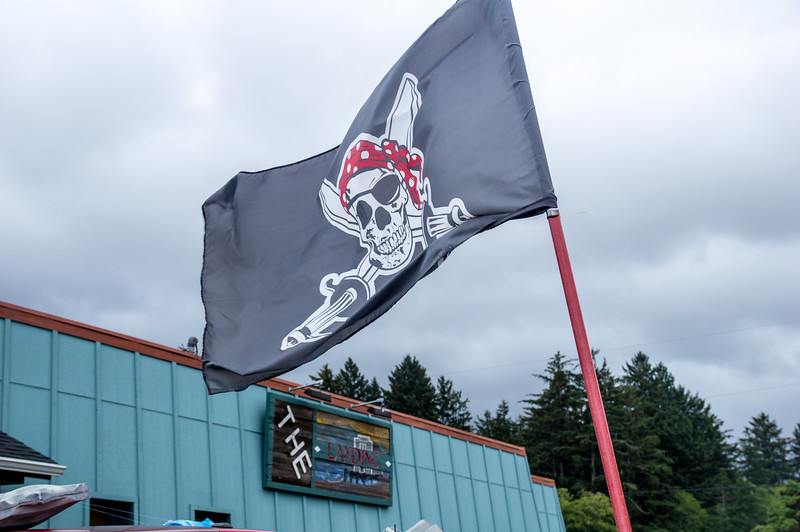 Pirate flag outside of The Landing Restaurant in Bay City, Oregon.