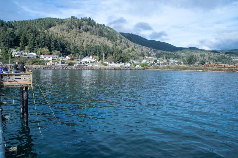 Crabbing at the Garibaldi Pier in Garibaldi, Oregon.