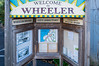 """Welcome to Wheeler"" interpretive sign, downtown Wheeler, Oregon"