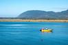 Wheeler Marina boat with Nehalem Bay and Neahkahnie Mountain, from Wheeler, Oregon