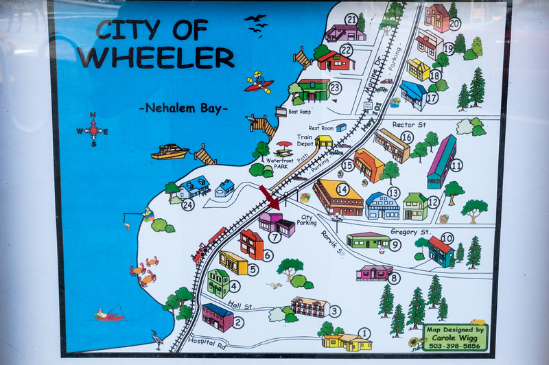 """Welcome to Wheeler"" interpretive sign, downtown Wheeler, Oregon"
