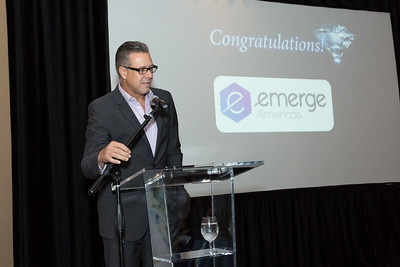 eMERGE Americas VP of Marketing, David Anon, accepting the Coral Gables large non-profit award