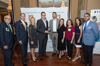 The eMERGE team accepting the Coral Gables Chamber large non-profit award.