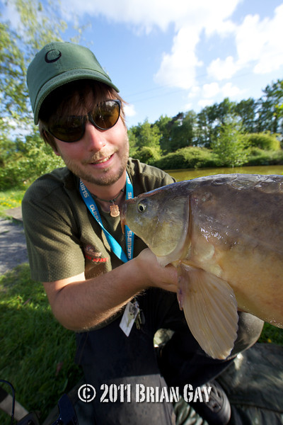 FLE's Graham Mabey displays a mirror carp caught on floating pellet from Canal 3