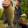Chris Telling holding a large tench.