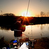 Winter Sunset on the Bristol Avon. A chub comes to the net, as the light fades chub often come on the feed.