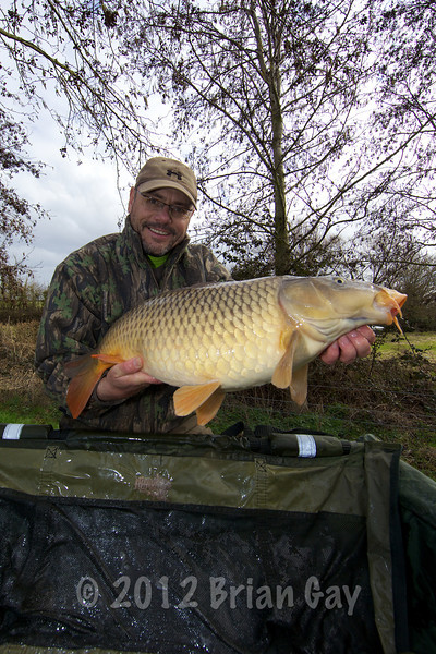 Brian gay with a 20-2-0 common caught on mainline cell boilie / Drennan buoyant corn combo from Burton Springs, Somerset.