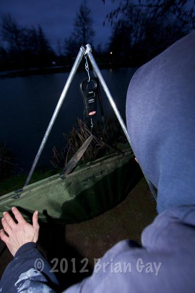 Simon Springell weighing a 21 lb carp