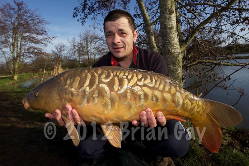 Jason Carr with a double  figure mirror swim 1 Burton Springs carp lake.