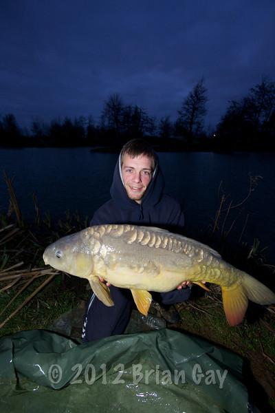 Simon Springell with a 21 lb mirror carp from Burton Springs
