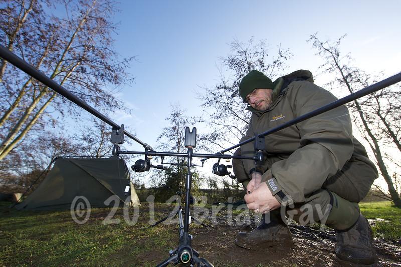 Brian Gay adjusting a bobbin while carp fishing at Burton Springs, Somerset, UK.