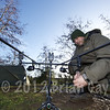 Brian Gay adjusting a bobbin while carp fishing at Burton Springs, Somerset, UK.