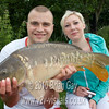 Rob Gardner with a low double mirror from Burton Springs Carp La, Somerset. Rob, 20, from Blackbrook, is pictured with girlfriend Phaedra Robbins. © 2010 Brian Gay.