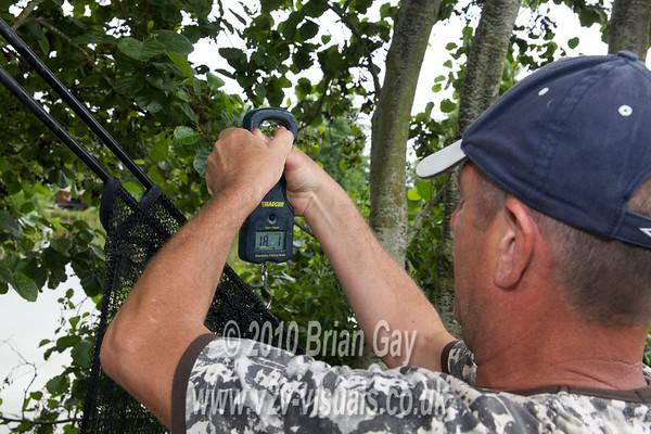 Mark Hunt, Bristol weighs his 18-1-0 grass carp caught from peg 3 at Burton Spring's Carp lake, Burton, Somerset. © 2010 Brian Gay