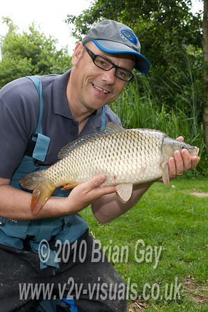 Brian Gay with a superb, but small for the lake, common carp carp at Burton Springs Carp Lake, Burton, Somerset.  © 2010 Brian Gay