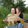 """Aaron North 23, and girlfriend Sabrina Bagwell from Taunton, with a 13 lb plus common from Burton Spring's Carp Lake . © 2010 Brian Gay  <form target=""""paypal"""" action=""""https://www.paypal.com/cgi-bin/webscr"""" method=""""post""""> <input type=""""hidden"""" name=""""cmd"""" value=""""_s-xclick""""> <input type=""""hidden"""" name=""""hosted_button_id"""" value=""""7YEUZ43VAT7D2""""> <table> <tr><td><input type=""""hidden"""" name=""""on0"""" value=""""Size"""">Size</td></tr><tr><td><select name=""""os0""""> <option value=""""7x5 Print"""">7x5 Print £4.27</option> <option value=""""5x5 Print"""">5x5 Print £4.27</option> <option value=""""9x6 Print"""">9x6 Print £8.39</option> <option value=""""12x8 Print"""">12x8 Print £14.39</option> <option value=""""20x16 Print"""">20x16 Print £42.95</option> <option value=""""30x20 Print"""">30x20 Print £72.39</option> </select> </td></tr> <tr><td><input type=""""hidden"""" name=""""on1"""" value=""""Finish"""">Finish</td></tr><tr><td><select name=""""os1""""> <option value=""""Matt"""">Matt </option> <option value=""""Gloss"""">Gloss </option> </select> </td></tr> </table> <input type=""""hidden"""" name=""""currency_code"""" value=""""GBP""""> <input type=""""image"""" src=""""https://www.paypal.com/en_GB/i/btn/btn_cart_SM.gif"""" border=""""0"""" name=""""submit"""" alt=""""PayPal - The safer, easier way to pay online.""""> <img alt="""""""" border=""""0"""" src=""""https://www.paypalobjects.com/WEBSCR-640-20110306-1/en_GB/i/scr/pixel.gif"""" width=""""1"""" height=""""1""""> </form>"""