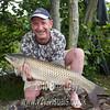 Mark Hunt, Bristol with his 18-1-0 grass carp caught from peg 3 at Burton Spring's Carp lake, Burton, Somerset. © 2010 Brian Gay