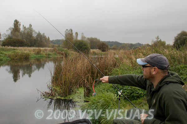 Note the baited waggler rig hanging from the rod tip while I loose feed. Loose feeding before casting in is often better than casting then feeding. Longham, Dorset Stour shoot, 161009. © 2009 Brian Gay.