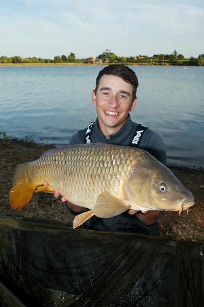 Shawn Kittridge with a  16 lb-plus Durleigh common carp. © 2014 Brian Gay / www.v2v-visuals.co.uk