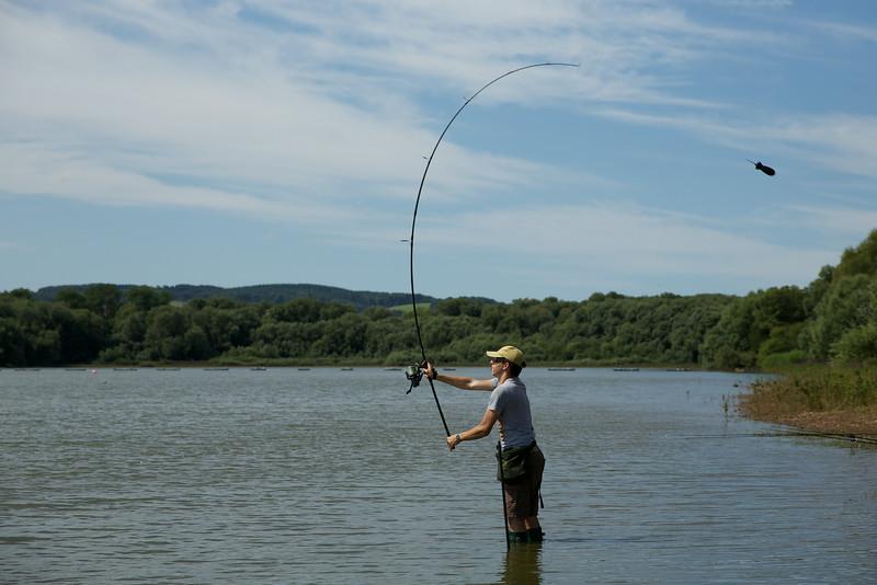 Shawm Kittridge casting a midi sized Spomb at Durleigh reservoir © 2014 Brian Gay © 2014 Brian Gay v2v-visuals.co,uk