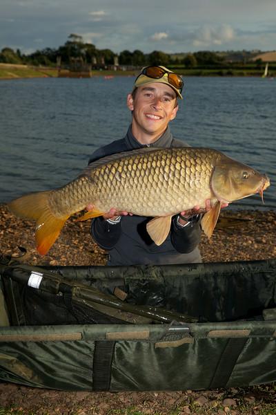 Shawn Kittridge holds a level 20 lb Durleigh common carp.