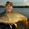 Shawn Kittridge holds a level 20 lb Durleigh common carp.