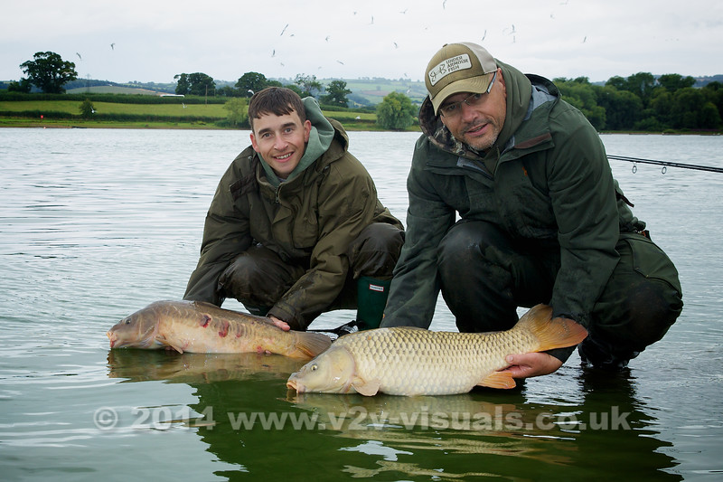 "We started the session both hooking double figure fish within minutes of each other at 10 am in the morning probably about a hour after starting. Shawn Kittridge (l) tempted the mirror carp with a Krill barrel bait tipped with a fluro pink pop-up. Brian Gay offered a single 20 mm bottom bait Nashbait Purple Monster squid boilie for his mind to upper double common.  Pic Hannah Clarke © 2014  <a href=""http://www.v2v-visuals.co.uk"">http://www.v2v-visuals.co.uk</a>"